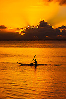 Sea kayaking at sunset, island of Moorea, French Polynesia.