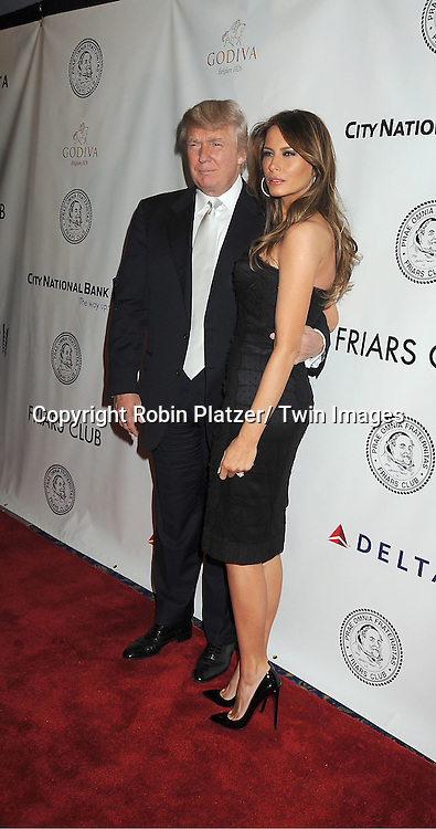 Donald Trump and wife Melania Trump attends The Friars Club Honors Larry King at a Gala Dinner on November 14, 2011 at The Sheraton New York Hotel in New York City.
