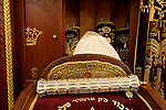 Israel, Bnei Brak. The Synagogue of the Premishlan congregation on Purim holiday. The Rabbi in front of the Torah, Purim Megillah is in the silver case, 2005<br />