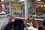 Glenn Ferrara (in leopard print) eats outside of McDonald's with friends from New Jersey in Punxsutawney, Pennsylvania following Punxsutawney Phil's prediction for a longer winter February 2, 2012.