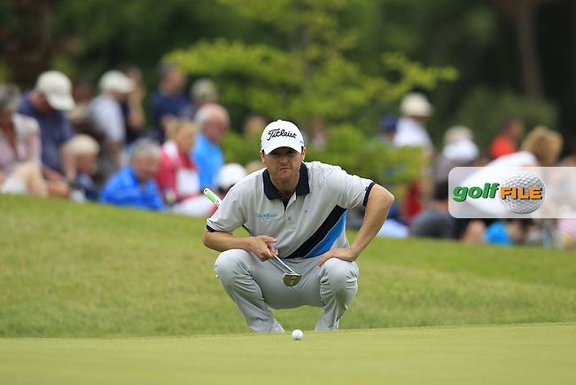 Michael Hoey (NIR) lines up his putt on the 14th green during Sunday's Final Round of the 2014 Irish Open held at Fota Island Resort, Cork, Ireland. 22nd June 2014.<br /> Picture: Eoin Clarke www.golffile.ie