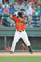 Shortstop Justin Twine (1) of the Greensboro Grasshoppers bats in a game against the Greenville Drive on Tuesday, August 25, 2015, at Fluor Field at the West End in Greenville, South Carolina. Greenville won, 7-0. (Tom Priddy/Four Seam Images)