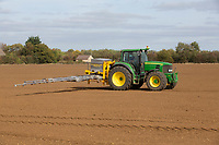 Contractor applying avadex granules<br /> &copy;Tim Scrivener Photographer 07850 303986<br />      ....Covering Agriculture In The UK....
