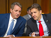 United States Senators Jeff Flake (Republican of Arizona), left, and Ben Masse (Republican of Nebraska), right, in discussion prior to hearing Judge Brett Kavanaugh testify before the United States Senate Judiciary Committee on his nomination as Associate Justice of the US Supreme Court to replace the retiring Justice Anthony Kennedy on Capitol Hill in Washington, DC on Tuesday, September 4, 2018.<br /> Credit: Ron Sachs / CNP<br /> (RESTRICTION: NO New York or New Jersey Newspapers or newspapers within a 75 mile radius of New York City)