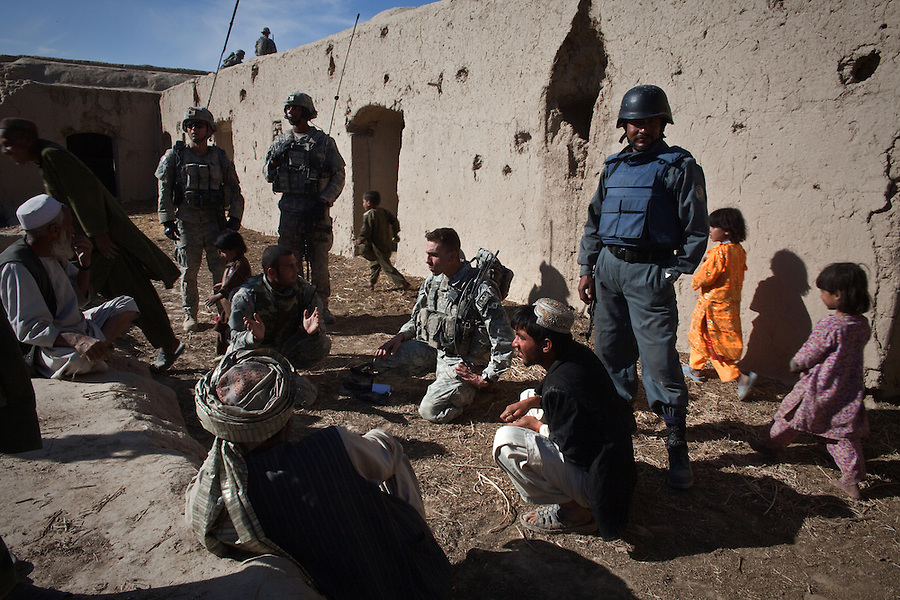 First Lt. Mark Morrison with Charlie Co. 1st Battalion 12th Infantry Regiment, 4th Infantry Division speaks with reluctant villagers in an abandoned  compound near his company's position - Combat Outpost JFM - in Zhari District, Kandahar, Afghanistan on January 22, 2010. The violently contested district sits astride the strategically Highway 1 ringroad between Kandahar and Lashkar Gah and is seen by some as the birthplace of the Taliban movement.