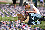 U.S. Army veteran Timothy Dempsey and other Western Nevada College Veterans Resource Center volunteers plant nearly 8,000 American flags at the campus, in Carson City, Nev., on Friday, May 1, 2015. The group will hold a Veterans Suicide Walk Saturday, May 2 at starting 10 a.m. at Bully's Sports Bar and Grill to help raise awareness of the 8,030 veteran suicides each year. <br /> Photo by Cathleen Allison/Nevada Photo Source