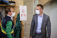 10.05.2020, Hoppegarten, Brandenburg, Germany;  Jockey Andrasch Starke and Trainer Henk Grewe with mouth nose protection and at distance in the jockey changing area