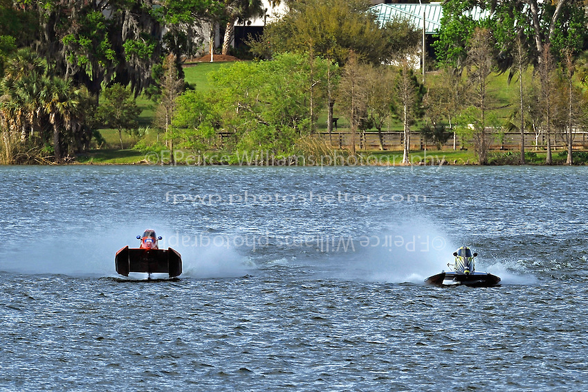 Brent Dillard, (#80) catches some air while trying to close in on leader Roddy Foreman (#22) (SST-60)