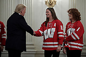 United States President Donald J. Trump greets athletes from the University of Wisconsin-Madison Women's Hockey Team as part of NCAA Collegiate National Champions Day at the White House in Washington on November 22, 2019. <br /> Credit: Yuri Gripas / Pool via CNP