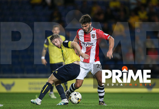 Alex Byrne of Exeter City battles with Dan Crowley of Oxford United during the The Checkatrade Trophy match between Oxford United and Exeter City at the Kassam Stadium, Oxford, England on 30 August 2016. Photo by Andy Rowland / PRiME Media Images.