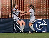 Mary Kroening (21) of Georgetown celebrates a goal with teammate Daphne Corboz (6) during the game at Shaw Field on the campus of Georgetown University in Washington, DC.  Georgetown tied DePaul, 1-1, in double overtime.