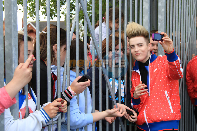 Presentation Primary School in Drogheda receive a visit from Jedward as the prize for collecting the most used mobile phones per student for the Jack and Jill Foundation. pictured here with girls who have been waiting for the arrival for two weeks.  ..(Photo credit should read Jenny Matthews www.newsfile.ie)....This Picture has been sent you under the conditions enclosed by:.Newsfile Ltd..The Studio,.Millmount Abbey,.Drogheda,.Co Meath..Ireland..Tel: +353(0)41-9871240.Fax: +353(0)41-9871260.GSM: +353(0)86-2500958.email: pictures@newsfile.ie.www.newsfile.ie.