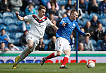 Andy Mitchell takes the ball away from Rory McAllister