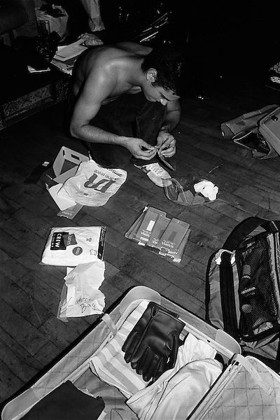 "Summer 2002, New York, NY.. Brock Enright, the mastermind behind the group, checks one of the many cases that are pre packaged for the kidnapping jobs..  In the summer of 2002, New York based artist, Brock Enright and a group of his friends from Virginia, started a kidnapping service called Videogames Adventure Services. The clients would hire them to provide a reality based kidnapping experience, while still retaining the ability to stop the ""game"" at anytime. Parameters were set ahead of the service, detailing the activities to be performed, but the actual time of the kidnapping was kept secret to add to the fantasy. An abuse fetish seemed to be shared by the clients as the activites were more physical than sexual in nature. Prices started at $2500 and the imagination of the client and actors were the only limits."