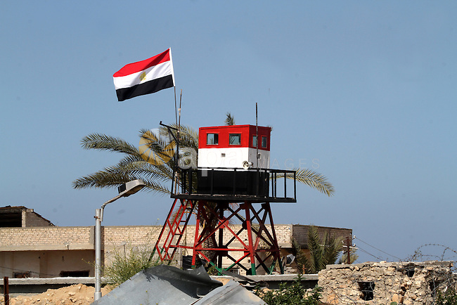 An Egyptian security guard on duty in a watch tower at the border between Egypt and southern Gaza Strip, on March 5, 2015. Gaza's border crossings will be reopened once control of them is handed over to the Palestinian Authority, Egypt's Ambassador to the Palestinian Authority (PA) Wael Attia said. Photo by Abed Rahim Khatib