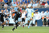 Kansas City forward Teal Bunbury (9) controlling the ball in the air... Sporting Kansas City defeated San Jose Earthquakes 2-1 at LIVESTRONG Sporting Park, Kansas City, Kansas.