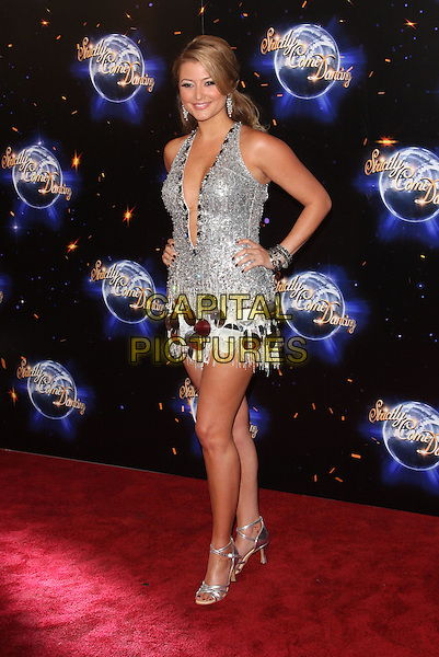 HOLLY VALANCE.London - 'Strictly Come Dancing' Launch Event at BBC Studios, London - September 7th 2011.full length silver dress hands on hips white tassels fringed plunging neckline sequins sequined studs studded .CAP/ROS.©Steve Ross/Capital Pictures