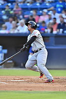 Hickory Crawdads designated hitter Yohel Pozo (3) swings at a pitch during a game against the Asheville Tourists at McCormick Field on August 16, 2018 in Asheville, North Carolina. The Crawdads defeated the Tourists 3-0. (Tony Farlow/Four Seam Images)
