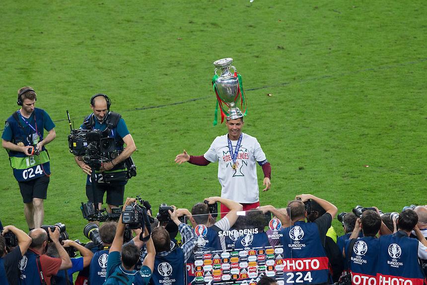 Portugal's Cristiano Ronaldo poses with the winners trophy <br /> <br /> Photographer Craig Mercer/CameraSport<br /> <br /> International Football - 2016 UEFA European Championship - Final - Portugal v France - Sunday 10th July 2016 - Stade de France - Saint-Denis - Paris - France<br /> <br /> World Copyright &copy; 2016 CameraSport. All rights reserved. 43 Linden Ave. Countesthorpe. Leicester. England. LE8 5PG - Tel: +44 (0) 116 277 4147 - admin@camerasport.com - www.camerasport.com