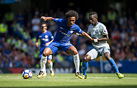 Willian of Chelsea holds off Idrissa Gueye of Everton during the Premier League match between Chelsea and Everton at Stamford Bridge, London, England on 27 August 2017. Photo by Andy Rowland.
