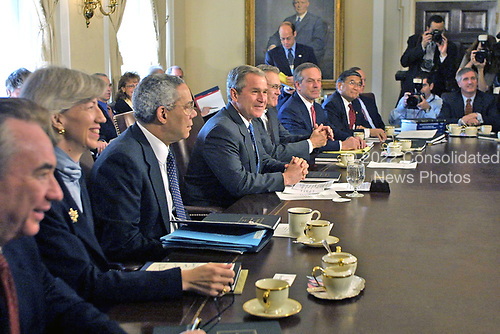 United States President George W. Bush holds a Cabinet meeting at the White House in Washington, D.C. on April 9, 2001.  During the meeting he made another statement on the China situation.  From left to right: US Secretary of Health and Human Services Tommy Thompson; US Secretary of Interior Gale Norton; US Secretary of State Colin Powell; President Bush; US Secretary of Defense Donald Rumsfeld; US Secretary of Commerce Don Evans; US Secretary of Transportation Norman Mineta; OMB Director Mitch Daniels (partially obscured); and White House Chief of Staff Andy Card.  White House Press Secretary Ari Fleischer is also visible in the upper center background.<br /> Credit: Jamal A. Wilson - Pool via CNP