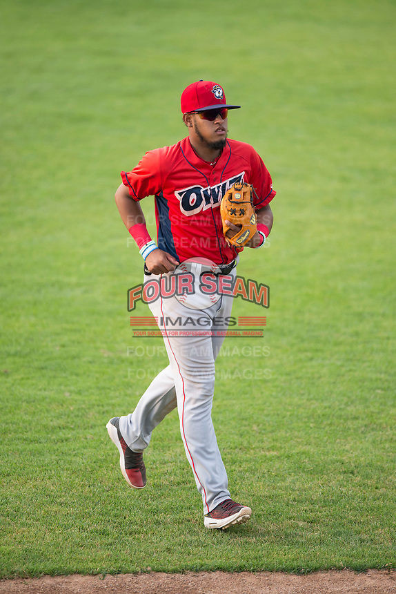 Orem Owlz third baseman Kevin Maitan (9) jogs off the field between innings of a Pioneer League game against the Missoula Osprey at Ogren Park Allegiance Field on August 19, 2018 in Missoula, Montana. The Missoula Osprey defeated the Orem Owlz by a score of 8-0. (Zachary Lucy/Four Seam Images)