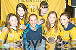Accepting their award from their sporting hero Tadhg Kennelly were Listowel Emmets Under 14 members of the Kerry squad Laura Foley, Caoimhe O'Sullivan, Sorcha McNulty, Alice Neville and Eibhlis Dillon.
