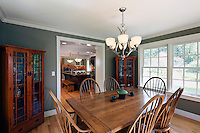 Traditional dining room with Arts & Crafts china cabinets