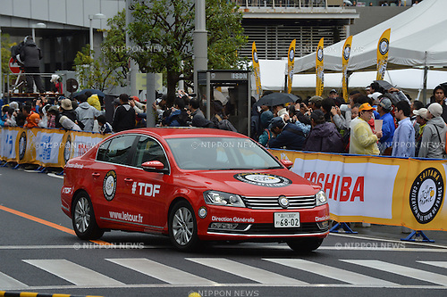 Cycling: Saitama Criterium by Le Tour de France, Saitama, Japan, Saturday 26th October, 2013. <br /> The first ever overseas race organised by Le Tour de France was held in Saitama, Japan. Despite fears of a typhoon the route was packed with spectators trying to get a glimpse of their heroes. They were rewarded with a thrilling final 20 lap race in which Chris Froome, Peter Sagan and Rui Costa broke free with two laps to go. Froome escaped on the last lap and Sagan beat Costa in a sprint for second. The whole event was came with all the trappings of Le Tour with the traditional red race car leading the pack.