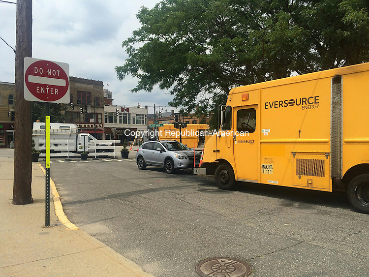 TORRINGTON, CT - 13 July 2015 - 071315CH1 -- Eversource Energy trucks parked on Franklin Street near the intersection of Main and East Main Streets for routine power maintanence Monday. Carrie Grace Henderson Republican-American