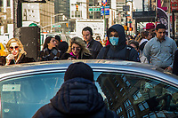 NEW YORK, NEW YORK - MARCH 4: A man wears a face mask as people walk through Times Square on March 4, 2020 in New York City. The coronavirus cases in New York has been doubled to 22. Eight new victims testing positive state wide Gov. Cuomo announced Thursday.. (Photo by Pablo Monsalve / VIEWpress)