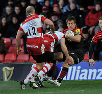 Watford, England. Chris Wyles of Saracens tackled during the Aviva Premiership match between Saracens and at Gloucester Rugby at Vicarage Road on December 2, 2012 in Watford, England.