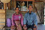 Kenyah elderly couple from Long Lawan in floating longhouse on the Bakun Dam reservoir. Home of the Kenyah native people who once lived in Long Geng, which was flooded by the Bakun Dam. Their community is now dispersed between Sungai Asap, Long Lewan and floating longhouses on the Bakun reservoir. Bakun Belaga region, Sarawak Borneo 2012<br />