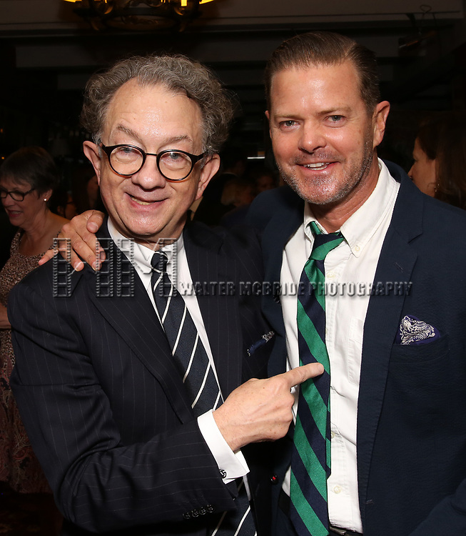 William Ivey Long and Clarke Thorell attend the William Ivey Long Sardi's portrait unveiling and 70th Birthday Party at Sardi's Restaurant on August 30, 2017 in New York City.
