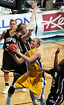 SIOUX FALLS, SD - MARCH 9: Ketty Cornemann #22 of SDSU takes the ball to the basket between Elizabeth Mercer #24 and Farren Stackhouse #22 of IUPUI in the second half of their semifinal game Monday afternoon at the Summit League Tournament in Sioux Falls. (Photo by Dave Eggen/Inertia)