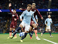 Manchester City's Kyle Walker shields the ball from 1899 Hoffenheim's Joelinton<br /> <br /> Photographer Rich Linley/CameraSport<br /> <br /> UEFA Champions League Group F - Manchester City v TSG 1899 Hoffenheim - Wednesday 12th December 2018 - The Etihad - Manchester<br />  <br /> World Copyright © 2018 CameraSport. All rights reserved. 43 Linden Ave. Countesthorpe. Leicester. England. LE8 5PG - Tel: +44 (0) 116 277 4147 - admin@camerasport.com - www.camerasport.com