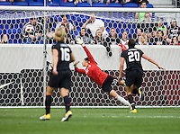 The shot Lauren Cheney (12) of the USWNT flies into the goal past Ceci Santiago (20) of Mexico during the game at Red Bull Arena in Harrison, NJ.  The USWNT defeated Mexico, 1-0.