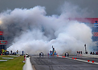 Apr 21, 2018; Baytown, TX, USA; Smoke fills the air as NHRA jet car driver Juan Cantu (left) launches off the starting line alongside Ray Kelly during qualifying for the Springnationals at Royal Purple Raceway. Mandatory Credit: Mark J. Rebilas-USA TODAY Sports