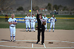 Western Nevada College Wildcats watch as High-Five singer Lynn Carasali, from Reno, throws out the first pitch before a college softball game at Edmonds Sports Complex in Carson City, Nev., on Friday, March 6, 2014. <br /> Photo by Cathleen Allison/Nevada Photo Source