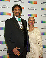 Carmen de LaVallade and her son, Leo Holder, arrive for the formal Artist's Dinner honoring the recipients of the 40th Annual Kennedy Center Honors hosted by United States Secretary of State Rex Tillerson at the US Department of State in Washington, D.C. on Saturday, December 2, 2017. The 2017 honorees are: American dancer and choreographer Carmen de Lavallade; Cuban American singer-songwriter and actress Gloria Estefan; American hip hop artist and entertainment icon LL COOL J; American television writer and producer Norman Lear; and American musician and record producer Lionel Richie. Photo Credit: Ron Sachs/CNP/AdMedia