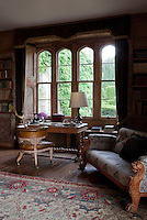 The gothic windows in the library have views over the extensive gardens at Lisnavagh House