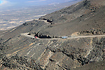 Cars driving on unsurfaced road, Atlantic Ocean coast, Jandia peninsula, Fuerteventura, Canary Islands, Spain