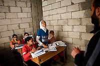 Syria, Deir az-Zor, 2013/03/17..In a western neighbourhood of deir az-Zor volunteers run a underground school to teach children lessons missed during heavy battles in town where schools have been targeted by shelling..Syrie, Deir ez-Zor, 17/03/2013.Dans un quartier ouest de Deir ez-Zor, des volontaires organisent une école clandestine pour enseigner aux enfants les leçons manquées durant des combats à l'arme lourde dans la ville pendant lesquels les écoles ont été ciblées par les bombardements..Photo: Timo Vogt / Est&Ost Photography.