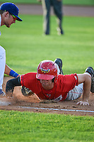 Michael Pierson (2) of the Orem Owlz dives back to first base during the game against the Ogden Raptors in Pioneer League action at Lindquist Field on June 18, 2015 in Ogden, Utah.  This was Opening Night play of the 2015 Pioneer League season. (Stephen Smith/Four Seam Images)