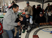 STAFF PHOTO FLIP PUTTHOFF <br /> LITTLE TRAINS, BIG TRAINS<br /> Mundo Harbaugh of Rogers and his son, Henry Harbaugh, age 2, work the controls of a model railroad set up on Saturday Dec. 6 2014 at the Arkansas &amp; Missouri Railroad depot in Springdale. A Christmas train event at the depot featured train rides with Santa on the A&amp;M excursion train and a Santa Village that included model train layouts, refreshments and holiday music.