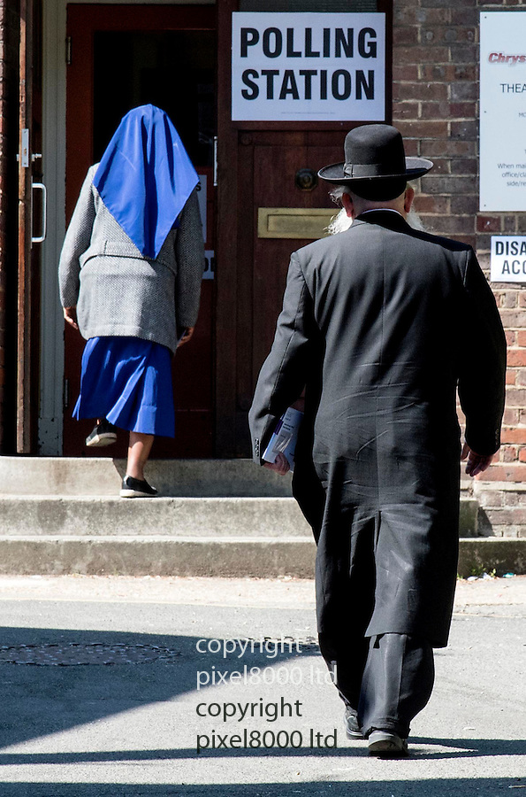 Pic shows; Polling station in Edgware today where Chief Rabbi was unable to vote.<br /> Another Rabbi arrives to make his vote in the London Mayor elections.<br /> He followed in a nun<br /> <br /> Pic by Gavin Rodgers/Pixel 8000 Ltd