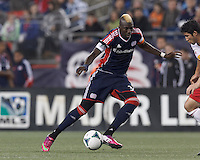 New England Revolution substitute forward Saer Sene (39) on the attack. In a Major League Soccer (MLS) match, the New England Revolution (blue) tied New York Red Bulls (white), 1-1, at Gillette Stadium on May 11, 2013.