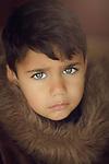 A little boy with sad face. Photo by Sanad Ltefa