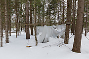 Abandoned campsite at Elbow Pond in Woodstock, New Hampshire USA during the winter months.