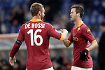 Calcio, ottavi di finale di Coppa Italia: Roma vs Atalanta. Roma, stadio Olimpico, 11 dicembre 2012..AS Roma midfielder Miralem Pjanic, of Bosnia, is congratulated by teammate Daniele De Rossi, left, after scoring during their Italy Cup last-16 tie football match between AS Roma and Atalanta at Rome's Olympic stadium, 11 december 2012. .UPDATE IMAGES PRESS/Riccardo De Luca